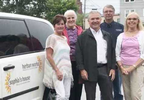 With the van are, from left, Kate O'Connor; Klara Tammany, director of the Center for Wisdom's Women; Phil O'Connor; Jim Titus, Coleman's employee; and Pat Titus, volunteer at the Center for Wisdom's Women.