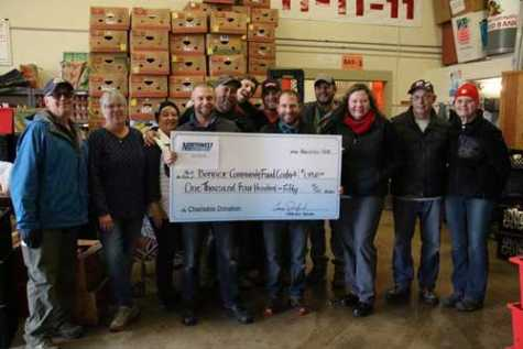 Pictured from left are Howard Shay, Mary Beth Childers and Linda Gibbs with the food bank; Eric Donenfeld, Kirk Dowd, Tim Greenwood, Jesse Hunt, Cory Donenfeld and Mike Umbaugh from Northwest Autobody; and Debbie Love, Dean Miller and Carol Warren with the food bank.