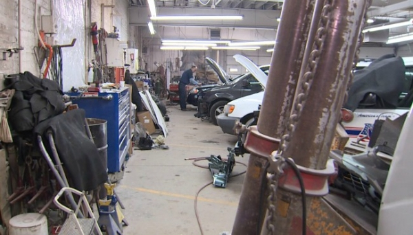 Mechanics work on vehicles on Dec. 28, 2017 at Wealthy Body Shop Inc. in Grand Rapids, MI.