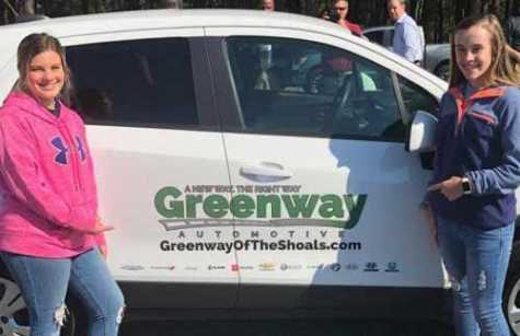 From left, Autumn Tharp and Rayanna James stand next to the new driver's education car donated to their Colbert Heights High School by Greenway Automotive. The company donated cars to several Shoals-area schools.
