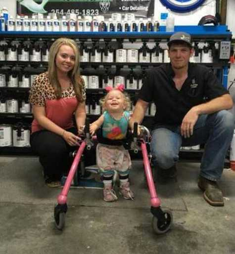 Justin McCann painted 2-year-old Addie King's walker in pink at his collision center for free.