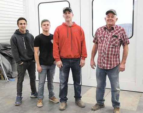 Posing in front of the new paint booth at Gary's Auto Body are (l-r) Alex Nicholson, Brian Crawford, owner Danny Jolley and founder Gary Jolley.