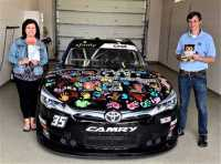 "Brenda Cortez, left, wrote a book with NASCAR driver Joey Gase, right,, ""Howl Goes to the Races,"" and is an advocate for organ donation awareness."