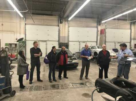 Auto body instructor Ken Neuman (far right) leads WAC members on a tour of the body shop at South Technical High School in St. Louis, MO.