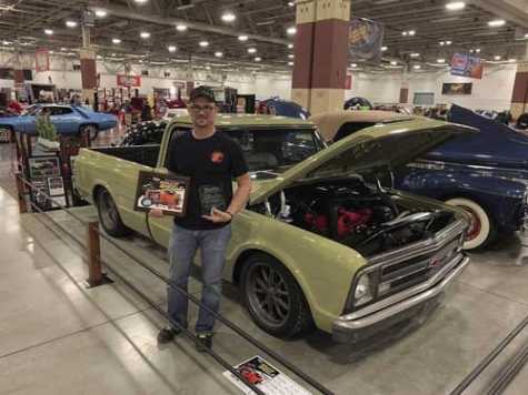 Eric Baneck of Fueled Customs is seen at the World of Wheels show in Milwaukee, WI, in February, where his 1967 C10 truck earned Best in Class.