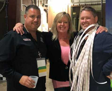 ATRI Executive Director Michelle Lechner (middle) poses with John Catalano of Bionic Auto Parts (left) and Joe Watson from ABC Auto Parts (right).