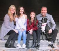Tim Morgan, his wife, Penny, and daughters, Samantha and Grace, started Second Chance Ranch in St. Charles, IL, and converted an old barn into a kennel.