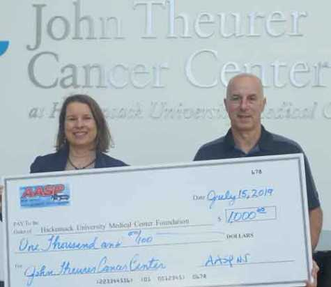 AASP/NJ President Jerry McNee visited the facility to formally present the check to Nancy Kennedy, director of development at Hackensack University Medical Center.