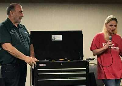 Toby Chess presented Samantha McCauley, a collision repair refinish instructor at Hammond High School in Hammond, IN, with two toolboxes during the Collision Industry Conference in July.