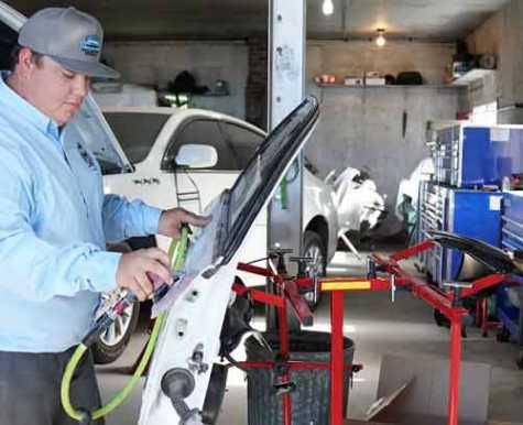 Clay Chittick sands down a car panel at his new business, Clay's Repair, LLC. Chittick credits the Auto Body Technology program at North Platte Community College for helping him achieve his dream.