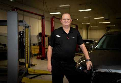 Eugen Petculescu is the collision manager at Infiniti of Las Vegas' auto body shop.