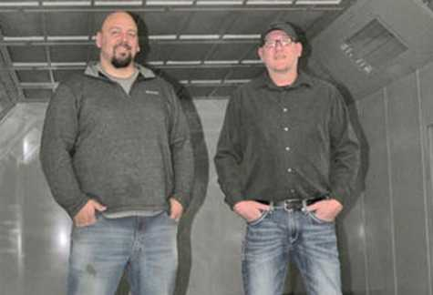 Adam Koster, the new owner of the Paullina Body Shop, pictured with Jarrod Harms who sold the business to Koster.