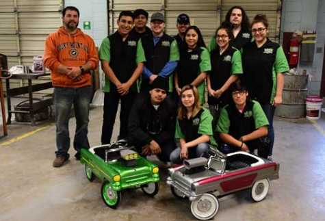 Students in the afternoon auto collision repair class at LeCroy Career Technical Center built and customized two pedal cars for Christmas presents.
