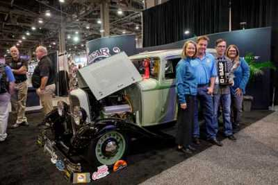 "The '32 Ford Sedan ""5th Avenue Special"" by Goolsby Customs takes home the 2019 Glasurit Best Paint Award. Pictured left toright: Jane Niemi, BASF Refinish NA Marketing Manager; Chip Foose from Foose Design; Jonathan Goolsby from Goolsby Customs; Tina Nelles, BASF Refinish NA Marketing Services Manager"