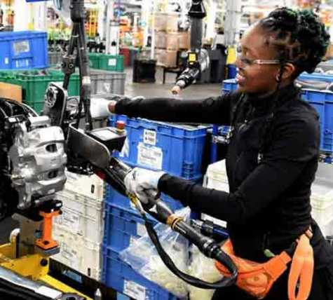 Ford employee Ebony Atkins-Conner installs the engine on a 2020 Ford Explorer at Chicago Assembly Plant.