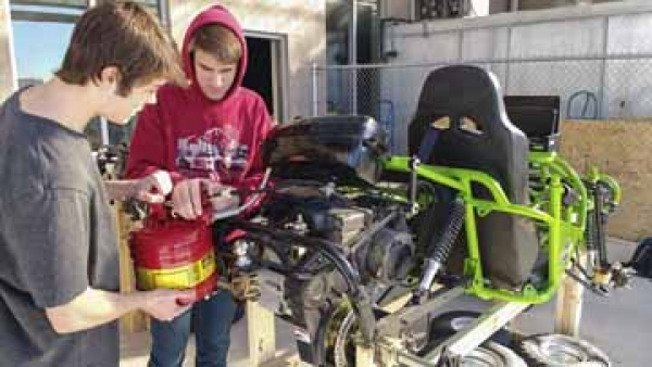Waverly juniors Ethan Qualset and Cameron Trail work on one of the Waverly go-karts.