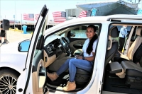 U.S. Coast Guard Yeoman PO2 Eladia Minton and her family received a completely refurbished vehicle from Mike's Auto Body on July 16 at a ceremony at the U.S.S. Hornet in Alameda, CA.