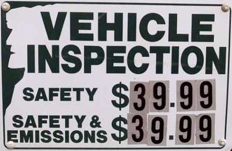 A sign outside a Lakes Region garage advertises the price for a state motor vehicle inspection, which motorists are required to get once a year. A state audit of 55 inspections stations in the Lakes Region found dozens of rules violations.