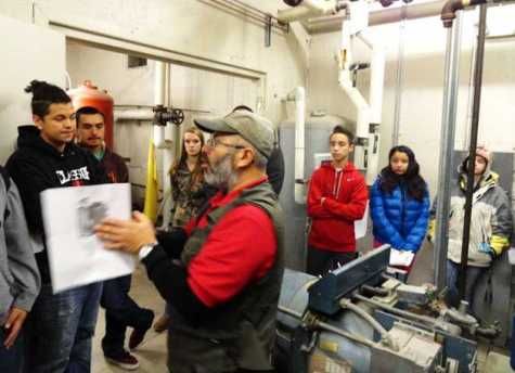 Mike Searle provides boiler training to a group of students at Minico High School during and industrial maintenance class at the school. The class will likely become part of the new ARTEC-I charter school.