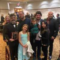 Dean Seif and his family after receiving the award for Citizen of the Year.