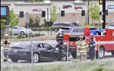A Utah woman who crashed her Tesla Model S into a Unified Fire Authority pickup in May when it was set on autopilot mode is suing the car manufacturer and Service King.