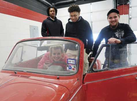 Lori Butler, a teacher at Greenville High School, gets a preview of what it'll be like to return to the driver's seat of her beloved 1979 Volkswagen Beetle. Students Quinton Bridges, Irelant Jones and Allen Fansler are a few of the young mechanics who have been working on her vehicle over the past year and a half.