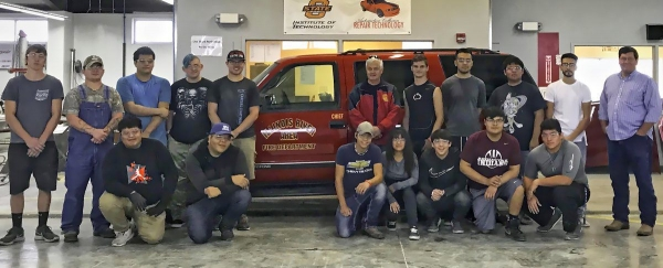 Auto body tech students from Indian Capital Technology Center prepped and painted a truck donated to Illinois River Area Fire Department from the Cherokee County Sheriff's Office. Students include, front row, from left: Chance Stayathome, Sidney Hair, Cody Terrapin, Elide Sierra, Mateo Taylor, Will Cozad, and Blayne Allen. Back row: Dalton Fritch, Chris Mills, Jorge Jordan, Jake Tillman, Kaleb Ruben, IRAFD Chief Stephen Alyea, Parker Warren, Martin Ruiz, Jeremy Russel, Jaime Herrera, and Instructor Bill Sprague.