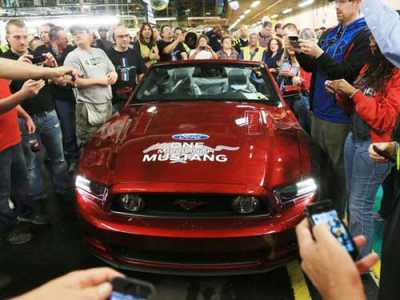 The Flat Rock Assembly Plant stands with the ruby red 2014 Mustang convertible that was the 1 millionth Ford Mustang built at the Flat Rock assembly after an event marking the milestone in April 2013.