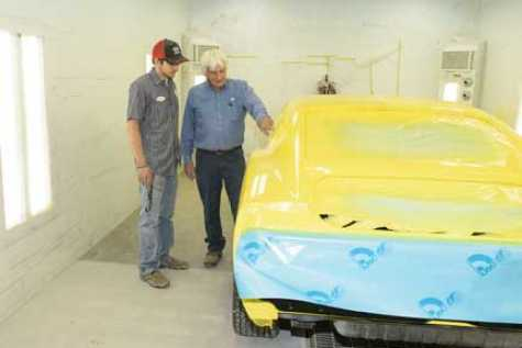 Anthony Hill receives painting tips from Don Wilson, auto body instructor at North Platte Community College.