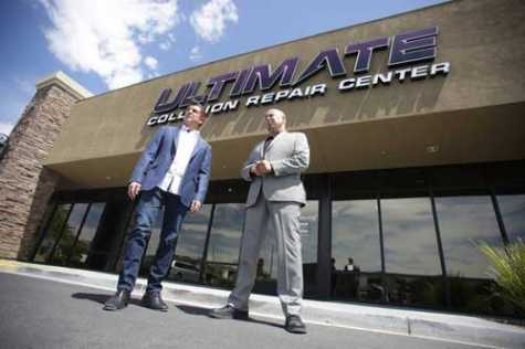 Ultimate Collision Repair Centers owner Brad Gothard, left, and manager Mario Watson stand in front of the company's Summerlin location on Friday, June 16, 2018.
