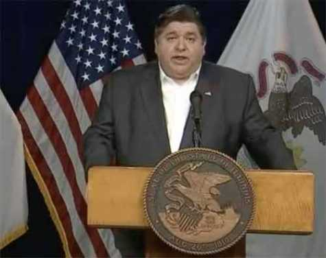 Gov. J.B. Pritzker speaks during a news conference on May 5 in Chicago.