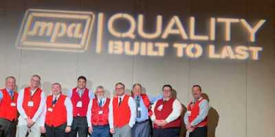 Outgoing Chair Dan Hanson was presented with his red vest in honor of his service to CAWA.