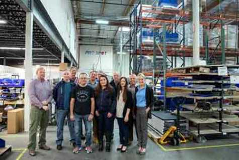 Group photo while touring Pro Spot's manufacturing facility in Carlsbad, CA