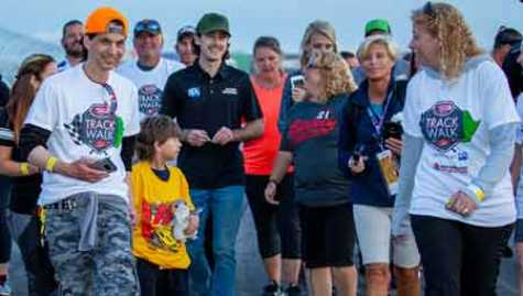 NASCAR driver Ryan Blaney (center) among the walkers at the Speedway Children's Charities Track Walk (photo courtesy of Scott Patten Photography)