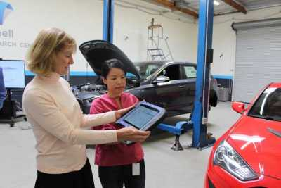 Barbara Davies, co-owner and general manager of Autobody News, received a demonstration of Mitchell Diagnostics from GeengYee Chong, product manager for Mitchell Auto Physical Damage.