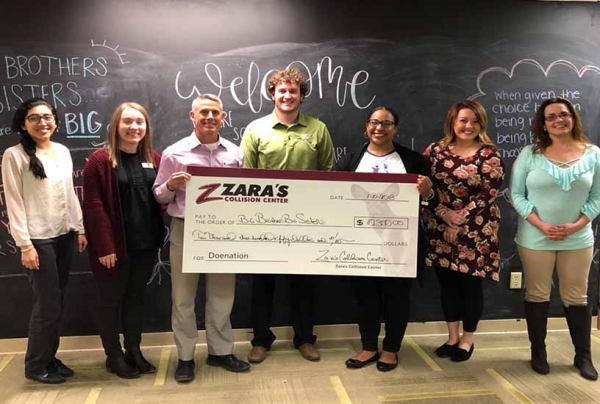Brad Zara (third from left) and Brady Smith (fourth from left) of Zara's Collision Center present the Doenation check to members of BBBS on Wednesday, Jan. 10.