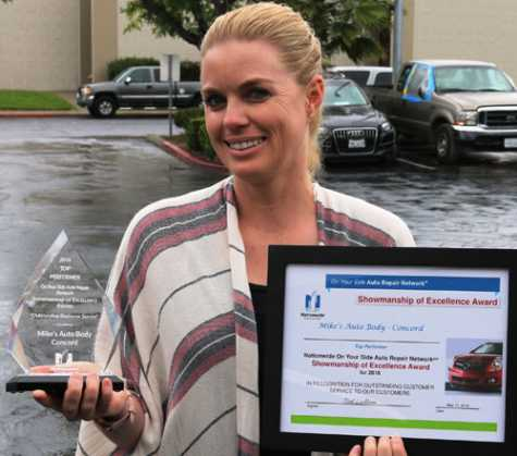Kristen Fedje, office manager at Mike's Auto Body's in Concord, CA, holds the 2018 On Your Side Showmanship of Excellence Award by Nationwide Insurance.