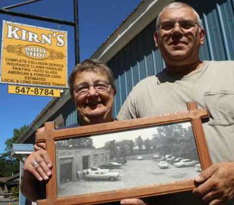 Don and Rosie Hoag this afternoon in front of Kirn's Body Shop on Route 28 south of the Cooperstown, NY, village line. They hold a photo of the original Kirn's, which opened in 1966 where the batting cages are today next to the Doubleday Field parking lot.