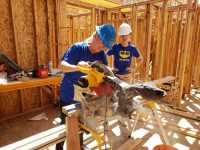Known as the WD-40 Tribe, company employees stepped up to change the world one home at a time by donating their time and skills for Habitat for Humanity.