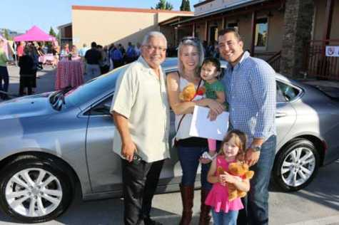 The gift of transportation, donated by Mike's Auto Body, helped Cassidy Nolan and his family grow and pursue their goals.  From left: Sal Contreras from Mike's Auto Body, Jillian Nolan, Cassidy Nolan and their two children.