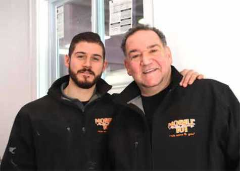 John Castallana Jr and his father John Castellana at the new brick-and-mortar location for Mobile Auto Body 101, located at 368 West Ave in Stamford.