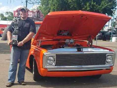 Austin Haynes with his award winning 1970 Chevrolet C 10 step side truck.