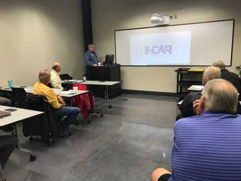 St. Louis I-CAR Committee Vice Chair of Training John Helterbrand provides an update for the group during its last meeting of 2018.
