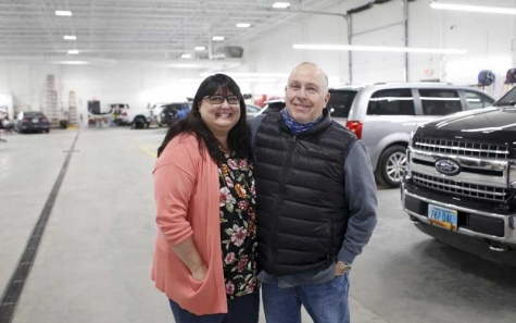 Deb and Ward Muscatell stand among the 24 service bays Jan. 12 in the Muscatell Collision Center, 1120 29th Ave. S., Moorhead.