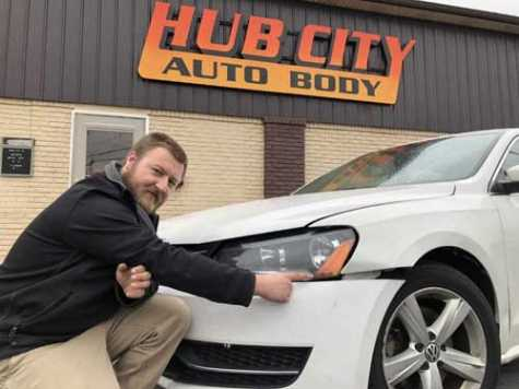 Rob Whittington, shop manager of Hub City Auto Body & Painting in Hagerstown, MD, points to damage that occurred when a Volkswagen struck a deer.