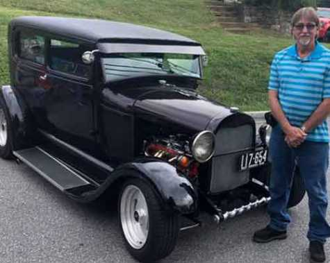 Glen Oden shows off his 1928 Model-A Ford at the 2nd Annual Roaring Car Show.